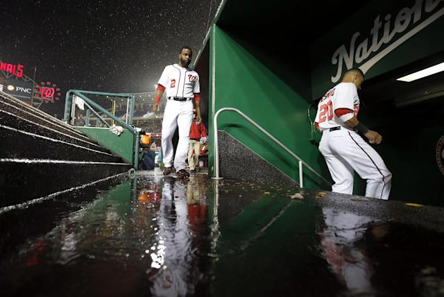 Washington Nationals center fielder Denard Span (2) follows shortstop Ian Desmond (20) into the clubhouse during a rain delay in the fourth inning of a baseball game against the Los Angeles Dodgers at Nationals Park, Monday, May 5, 2014, in Washington. (AP Photo/Alex Brandon)