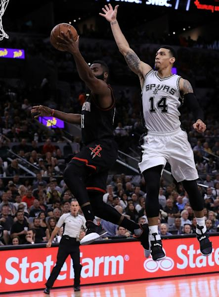 James Harden of the Houston Rockets takes a shot against Danny Green of the San Antonio Spurs in Game One of the NBA Western Conference semi-finals, at AT&T Center in San Antonio, Texas, on May 1, 2017