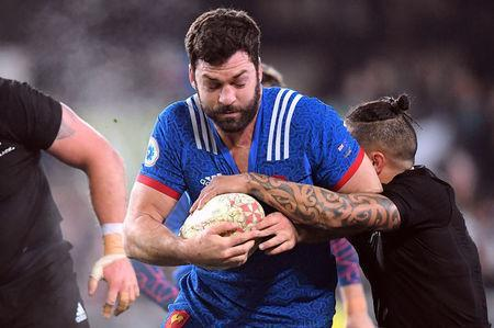 Rugby Union - June Internationals - New Zealand vs France - Forsyth Barr Stadium, Dunedin, New Zealand - June 23, 2018 - Kevin Gourdon of France is held by Aaron Smith of New Zealand. REUTERS/Ross Setford