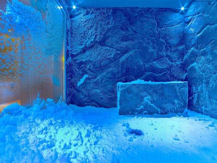 a blue room full of snow and ice