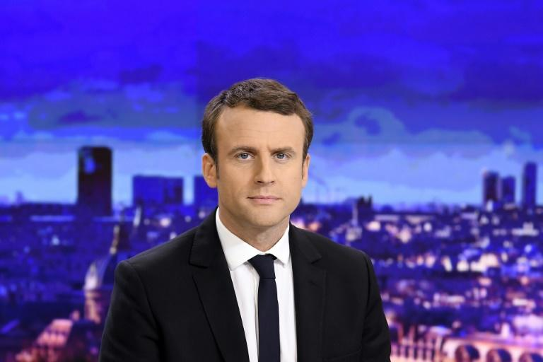French presidential election candidate for the En Marche ! movement Emmanuel Macron waits before an interview on the set of the French channel France 2 news evening broadcast on April 25, 2017 in Paris