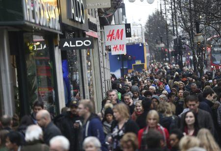 FILE PHOTO: Shoppers walk along Oxford Street in London, Britain December 18, 2016. REUTERS/Neil Hall/File Photo
