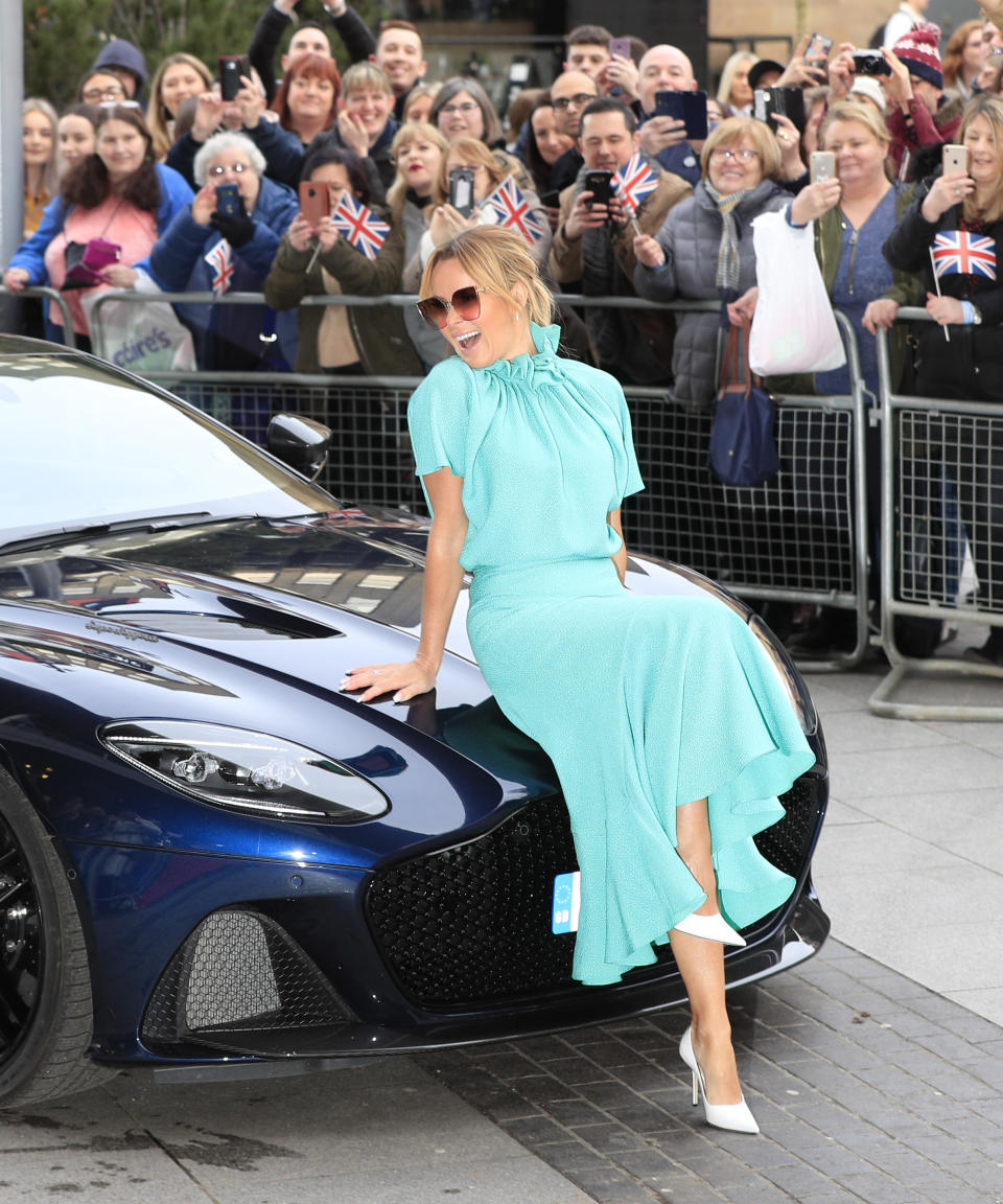 Amanda Holden accessorised the Edeline Lee dress with a pair of Jimmy Choo heels and Fendi sunglasses [Getty]