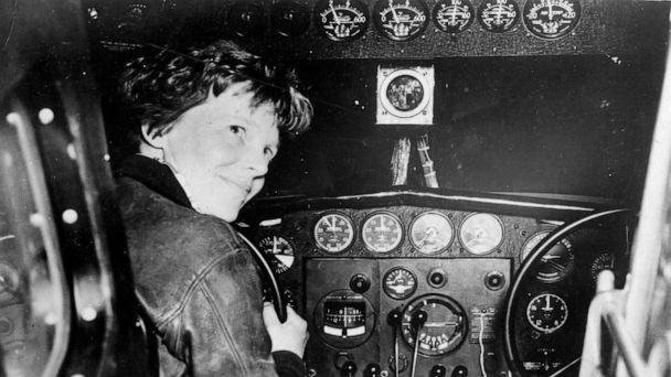 PHOTO: Amelia Earhart in the cockpit of a plane. (National Archives/HISTORY)