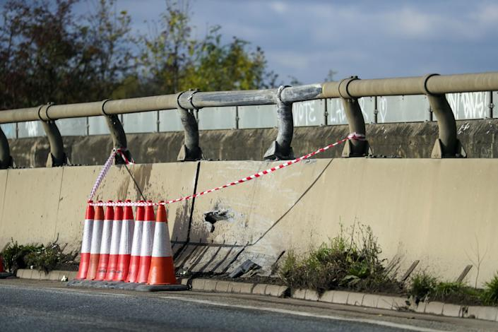 Damage to road barriers on the A40 near Oxford where a four-year-old girl, a six-year-old boy, an eight-year-old girl and a 29-year-old woman from Chinnor, Oxfordshire, died Monday night after a collision between a people carrier and a heavy goods vehicle.