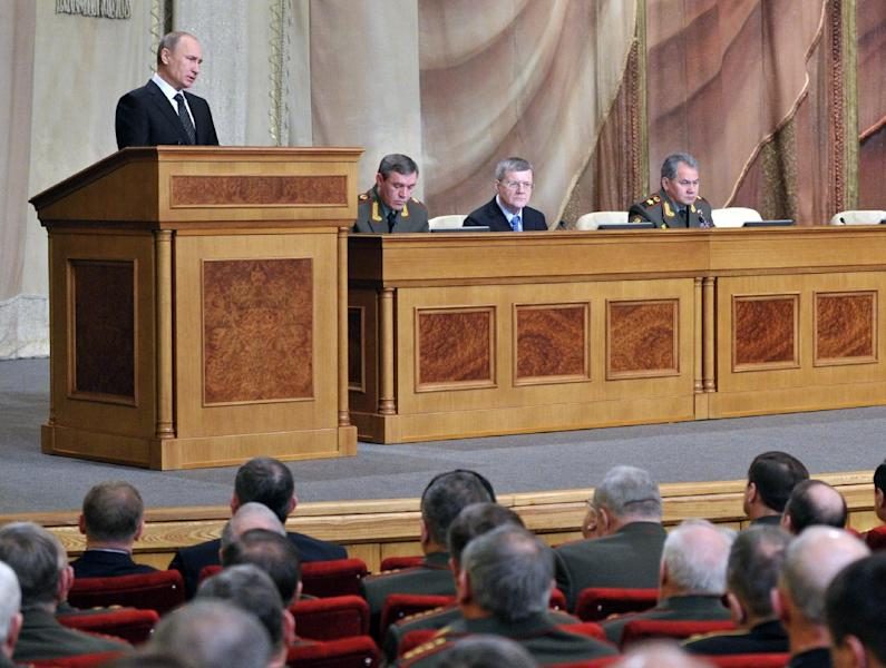 "Russian President Vladimir Putin, left, addresses senior military officials in Moscow on Wednesday, Feb. 27, 2013. Russian President Vladimir Putin has called on the country's top brass to deliver a drastic upgrade of the armed forces in the next three years to fend off attempts from abroad to ""tip the strategic balance"" in the world. Defense Minister Sergei Shoigu sits at right. (AP Photo/RIA Novosti, Alexei Nikolsky, Presidential Press Service)"