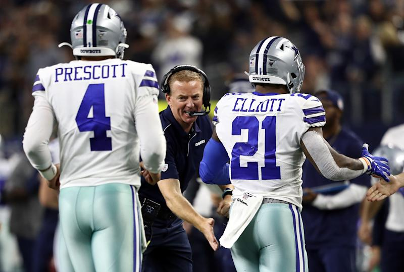 ARLINGTON, TEXAS - NOVEMBER 28: Head coach Jason Garrett of the Dallas Cowboys celebrates a touchdown with Dak Prescott #4 and Ezekiel Elliott #21 against the Buffalo Bills at AT&T Stadium on November 28, 2019 in Arlington, Texas. (Photo by Ronald Martinez/Getty Images)