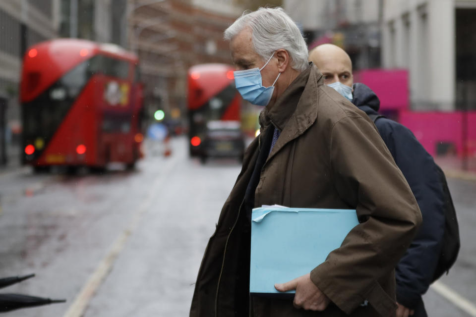 European Union chief Brexit negotiator Michel Barnier, foreground, walks to the Conference Centre in London, Thursday, Dec. 3, 2020. With less than one month to go before the U.K. exits the EU's economic orbit, talks are continuing, and U.K. officials have said this is the last week to strike a deal. (AP Photo/Kirsty Wigglesworth)