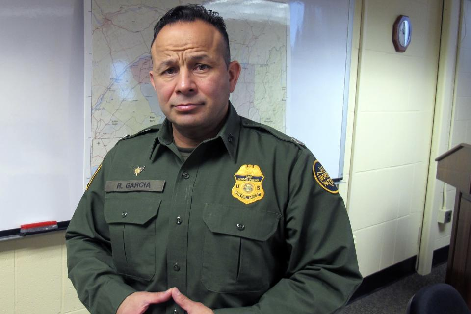 In this Monday Feb. 10, 2020, PHOTO, Robert Garcia, the chief of the U.S. Border Patrol's Swanton sector, poses at sector headquarters in Swanton, Vt. Statistics show that the 295-mile Swanton Sector of upstate New York, Vermont and New Hampshire, sees the most illegal border crossing of any sector along the 4,000-mile U.S.-Canadian border. (AP Photo/Wilson Ring)