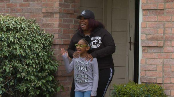 PHOTO: Hurtado's student Nia Mays, 2nd grade, and her mom Kisha Montgomery outside their house waving goodbye to Hurtado. (Courtesy Ted Madden/Mesquite ISD)