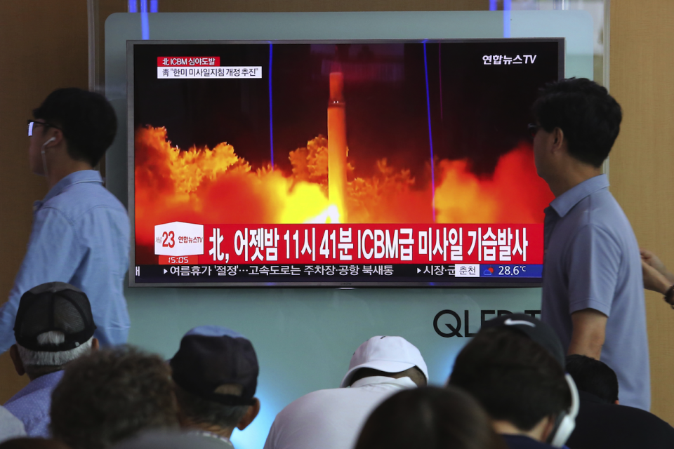 A North Korean missile launch is televised (Picture: REX Features)