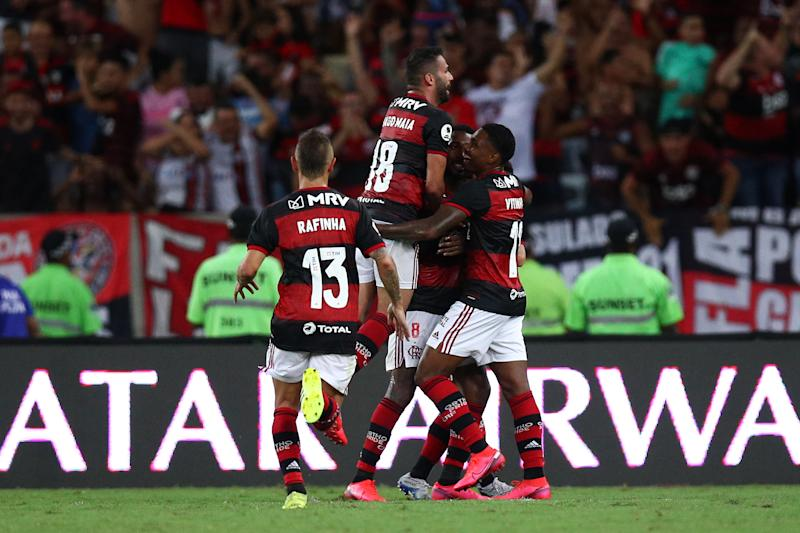 RIO DE JANEIRO, BRAZIL - FEBRUARY 26: Gerson of Flamengo celebrates with teammates the third goal of his team during the second leg match between Flamengo and Independiente del Valle as part of Recopa Sudamericana 2020 at Maracana Stadium on February 26, 2020 in Rio de Janeiro, Brazil. (Photo by Buda Mendes/Getty Images)