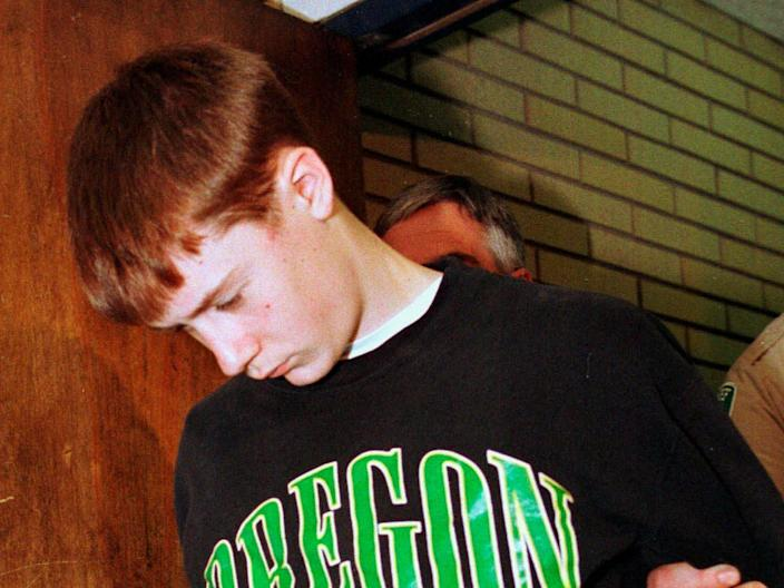 In this May 22, 1998, file photo, Thurston High School student Kip Kinkel, 15, is led to his arraignment in Eugene, Ore. (AP)