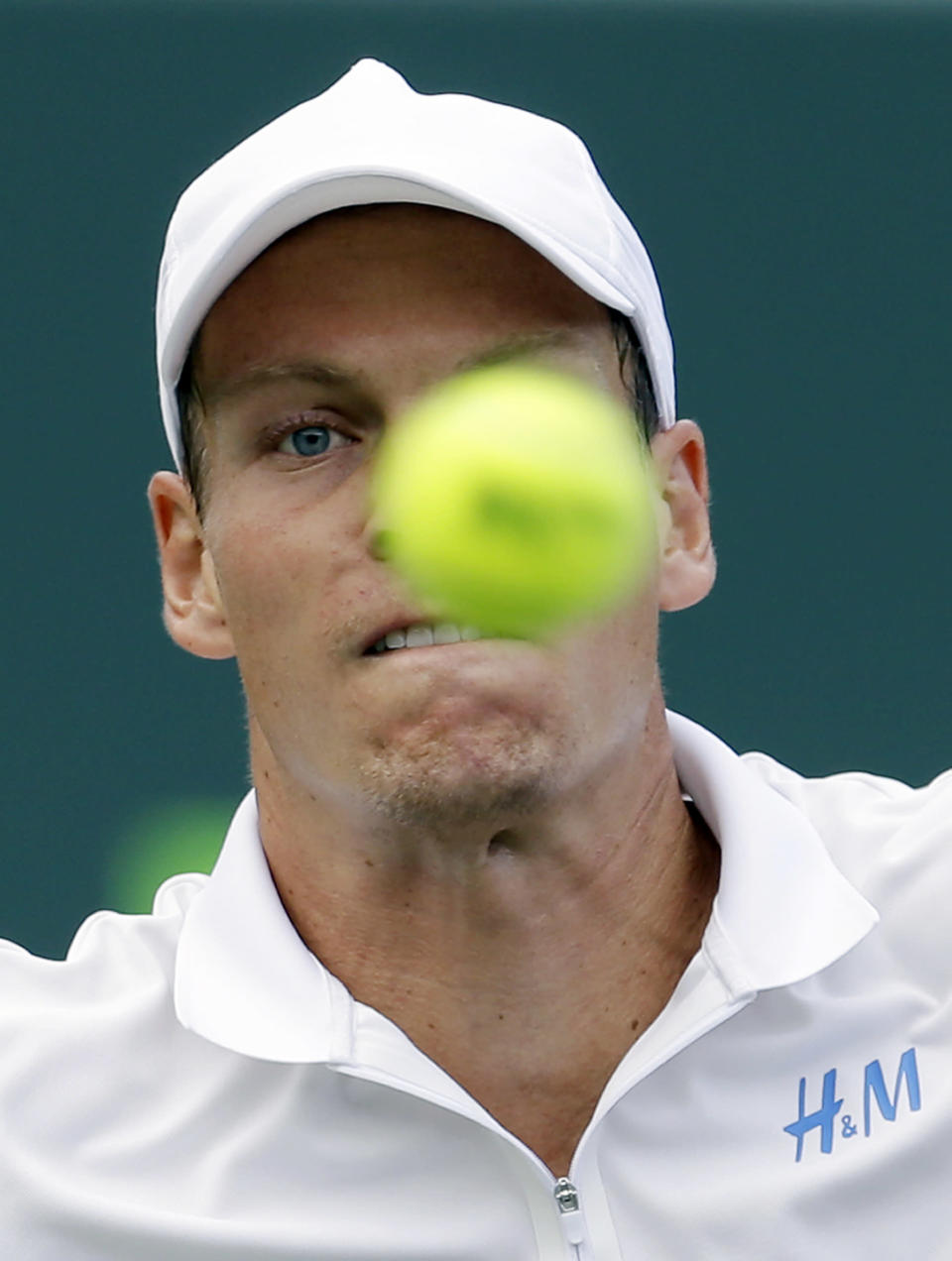 Tomas Berdych, of the Czech Republic, keeps his eyes on the ball as he returns to Alexandr Dolgopolov, of Ukraine, at the Sony Open Tennis tournament in Key Biscayne, Fla., Thursday, March 27, 2014. Berdych won 6-4, 7-6 (3). (AP Photo/Alan Diaz)