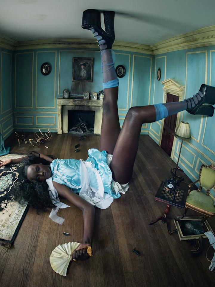 <p>Model Duckie Thot stars in the calendar, as Alice in Wonderland. </p>