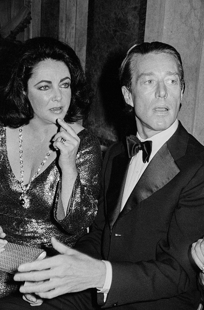 <p>The designer's social circle was famously star-studded. He's pictured here at an event with Elizabeth Taylor.</p>