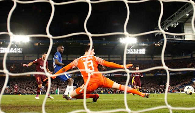Soccer Football - Champions League Round of 16 First Leg - Chelsea vs FC Barcelona - Stamford Bridge, London, Britain - February 20, 2018 Barcelona's Lionel Messi scores their first goal Action Images via Reuters/Andrew Boyers