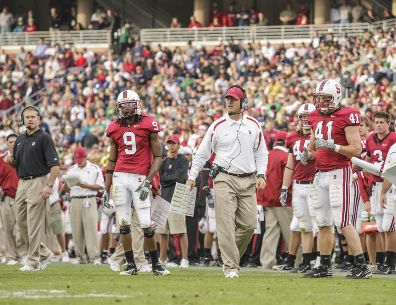 PALO ALTO, CA - NOVEMBER 24: Jim Harbaugh, head coach of the Stanford Cardinal, watchs from the sidelines during an NCAA football game against the Notre Dame Irish played on November 24, 2007 at Stanford Stadium in Palo Alto, California. Visible players include Richard Sherman #9 and Tom McAndrew #41. (Photo by David Madison/Getty Images)