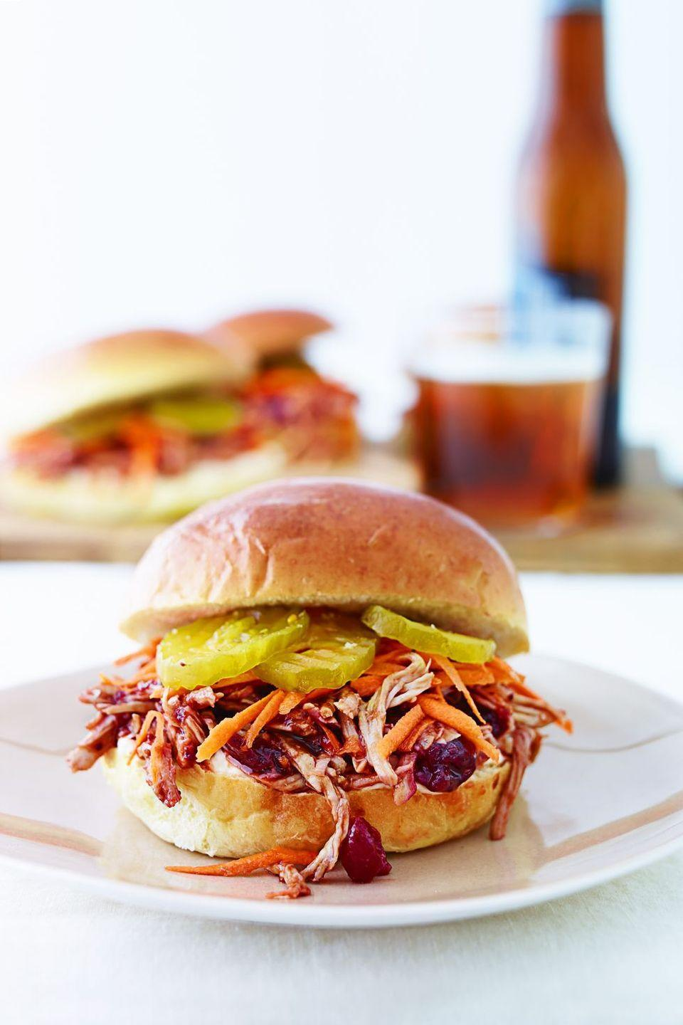"""<p>Transform leftover cranberry sauce into a tangy-sweet BBQ sauce you can slather all over pulled turkey and serve for lunch <em>or </em>dinner.</p><p><em><a href=""""https://goodhousekeeping.com/food-recipes/a11853/pulled-cran-turkey-sandwiches-recipe-ghk1114/"""" rel=""""nofollow noopener"""" target=""""_blank"""" data-ylk=""""slk:Get the recipe for Pulled Cran-Turkey Sandwiches »"""" class=""""link rapid-noclick-resp"""">Get the recipe for Pulled Cran-Turkey Sandwiches »</a></em><br></p>"""