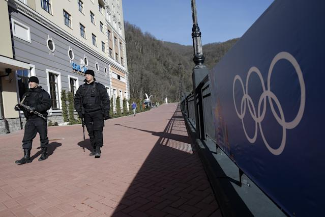 Russian security forces patrol the streets of the Rosa Khutor ski resort in Krasnaya Polyana, Russia, ahead of the Sochi 2014 Winter Olympics, Friday, Feb. 7, 2014. (AP Photo/Christophe Ena)