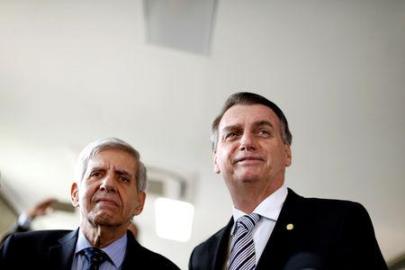 FILE PHOTO: Brazil's President-elect Jair Bolsonaro (R) and his choice for Defense Minister, former General Augusto Heleno, stand together, in Brasilia, Brazil November 7, 2018. REUTERS/Adriano Machado/File Photo