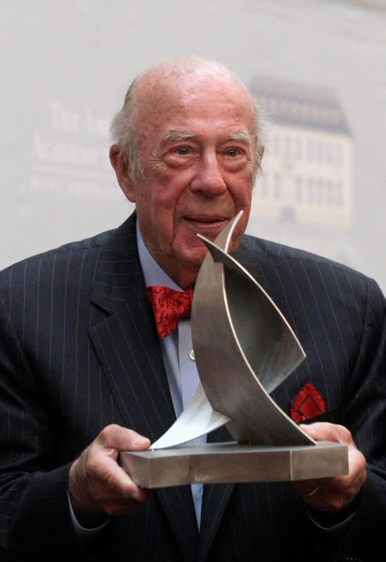 FILE PHOTO: Former U.S. Secretary of State Shultz poses with the 'Henry A. Kissinger Prize' trophy in Berlin