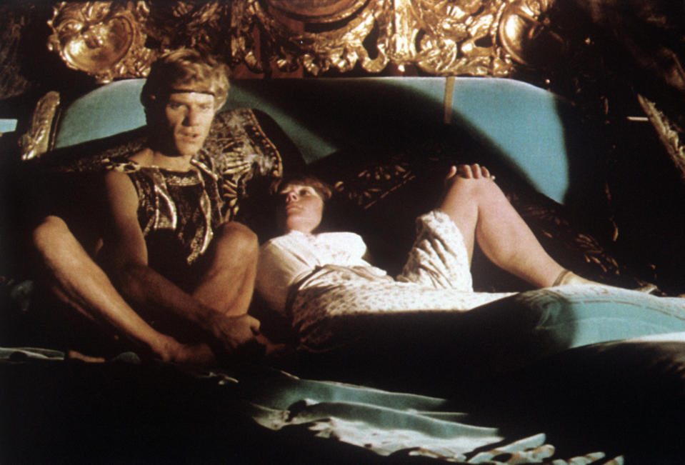 British actors Teresa Ann Savoy playing the role of Drusilla and Malcolm McDowell (Malcolm John Taylor) playing the role of the Emperor Caligula talking in bed in the film Caligula, My Son. 1979. (Photo by Mondadori via Getty Images)