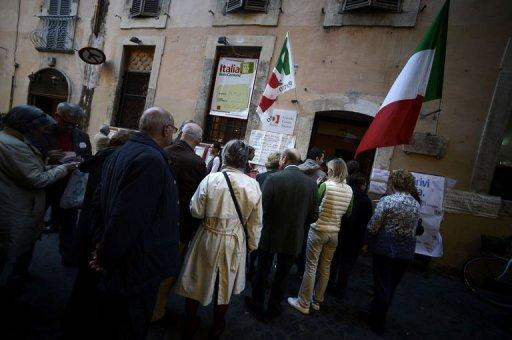 Democratic Party supporters queue at a party polling station in Rome