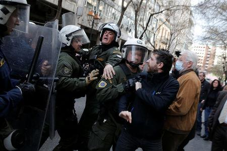 Demonstrators are pushed back by with riot police officers during a protest against home auctions in Athens, Greece, March 14, 2018. REUTERS/Costas Baltas