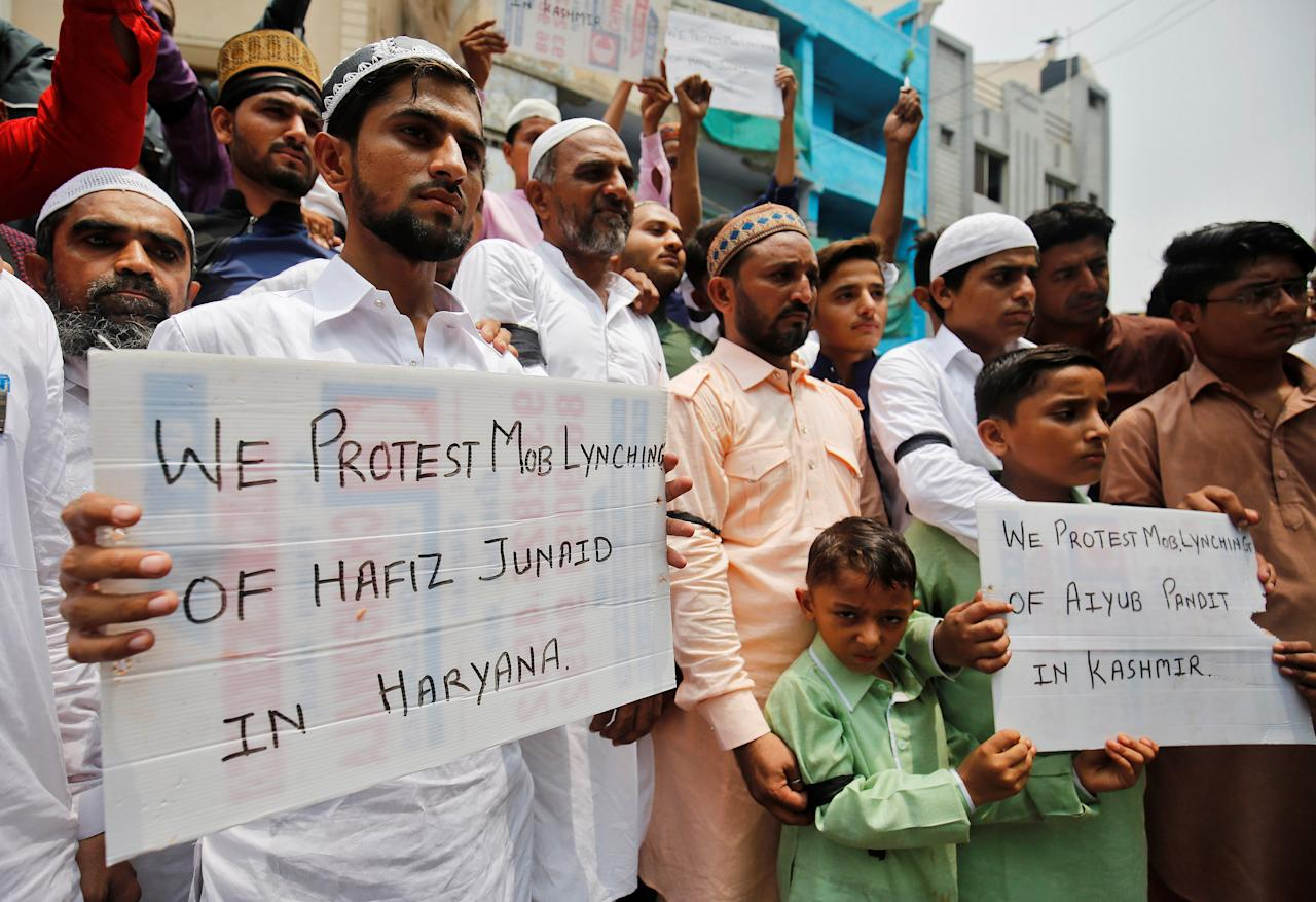 Muslims hold banners as they protest against the recent cases of mob lynching of Muslims who were accused of possessing beef, after offering Eid al-Fitr prayers in Ahmedabad, India June 26, 2017. REUTERS/Amit Dave