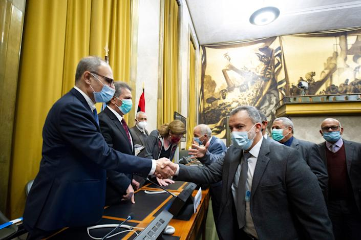 Participants of the fourth round of the 5+5 Libyan Joint Military Commissionsign shaking hands after signing an Agreement for a Complete and Permanent Ceasefire in Libya, at United Nation's Palais des Nations in Geneva, Switzerland, 23 October 2020. According to the United Nations (UN), the two rival sides in the Libyan civil war have agreed on a nationwide ceasefire.  (EPA/Violaine Martin / UN) (EPA)