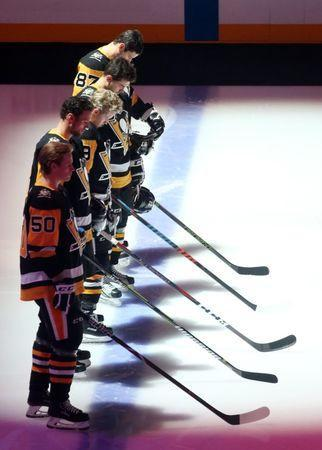 Oct 30, 2018; Pittsburgh, PA, USA; The Pittsburgh Penguins starting line up during an eleven second moment of silence in honor of the Tree of Life Synagogue shooting victims before the game against the New York Islanders at PPG PAINTS Arena. New York won 6-3. Mandatory Credit: Charles LeClaire-USA TODAY Sports
