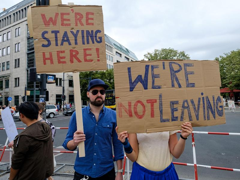 British expats hold up signs to protest Brexit: Getty