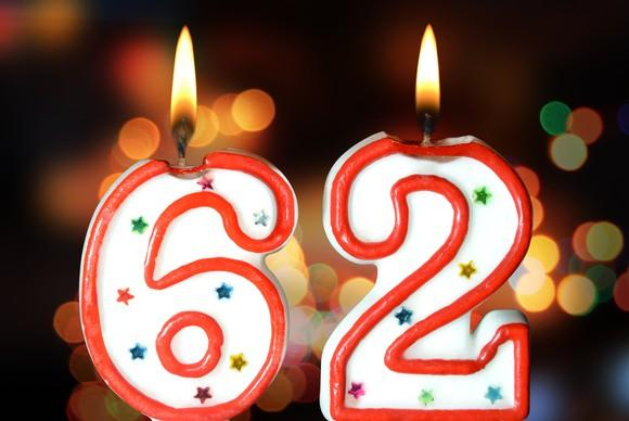 two lit candles, one the number six and one the number two