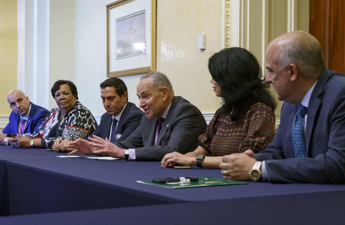Senate Majority Leader Chuck Schumer, D-N.Y., is flanked by Texas Rep. Trey Martinez Fischer of San Antonio, left, and Texas Sen. Carol Alvarado of Houston, as he meets with Texas Democratic lawmakers to discuss voting rights, at the Capitol in Washington, Tuesday, June 15, 2021. Two weeks ago the Democrats walked out of the Texas House of Representatives to block passage of a new restrictive voting law. (AP Photo/J. Scott Applewhite) .