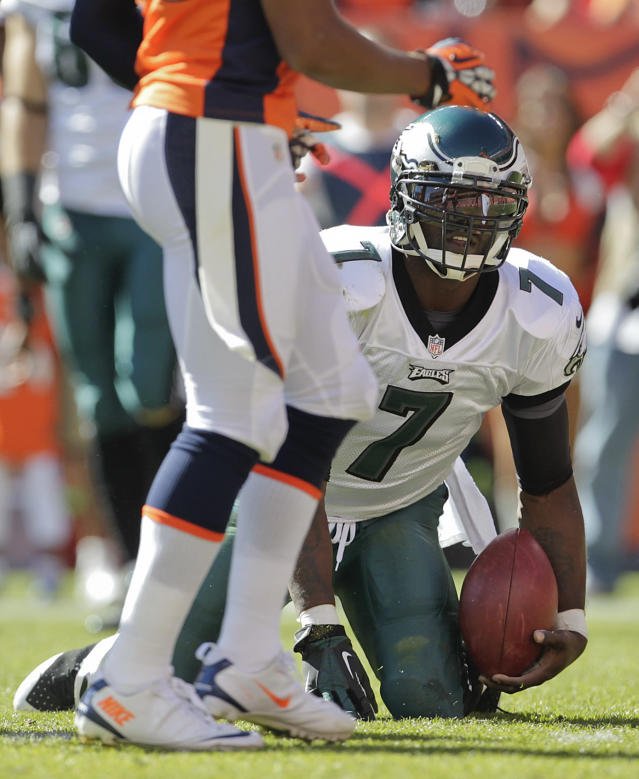 Philadelphia Eagles quarterback Michael Vick (7) gets up off the turf after running the ball against the Denver Broncos in the first quarter of an NFL football game, Sunday, Sept. 29, 2013, in Denver. (AP Photo/Joe Mahoney)