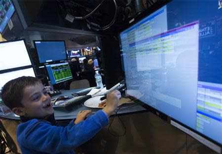Nicoli Babino works at a post on the floor of the New York Stock Exchange November 29, 2013. REUTERS/Brendan McDermid