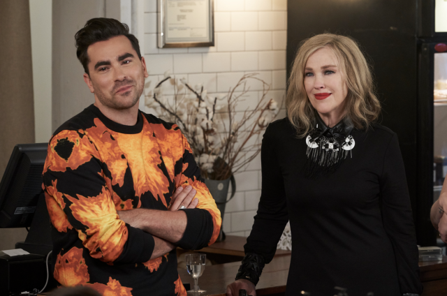 David (Dan Levy) and Maura (Catherine O'Hara) swoon over a serenade from Patrick (Noah Reid) on 'Schitt's Creek.' (Photo: Pop)
