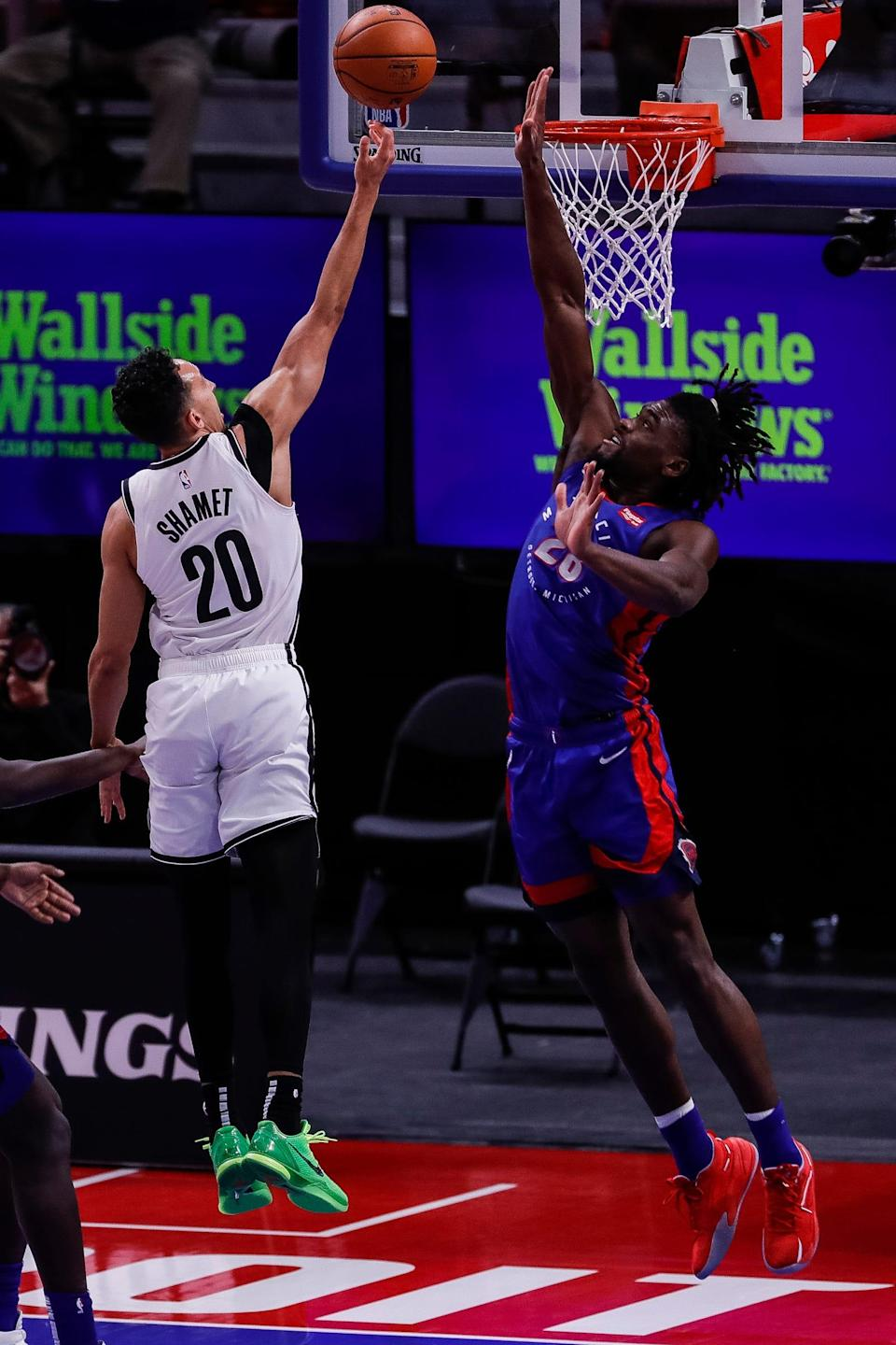 Detroit Pistons center Isaiah Stewart tries to block a layup from Brooklyn Nets guard Landry Shamet during the first half at Little Caesars Arena, Tuesday, Feb. 9, 2021.