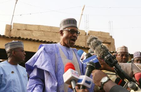 Nigerian President Muhammadu Buhari talks to the media as he arrives to cast a vote in Nigeria's presidential election at a polling station in Daura, Katsina State, Nigeria, February 23, 2019. REUTERS/Afolabi Sotunde