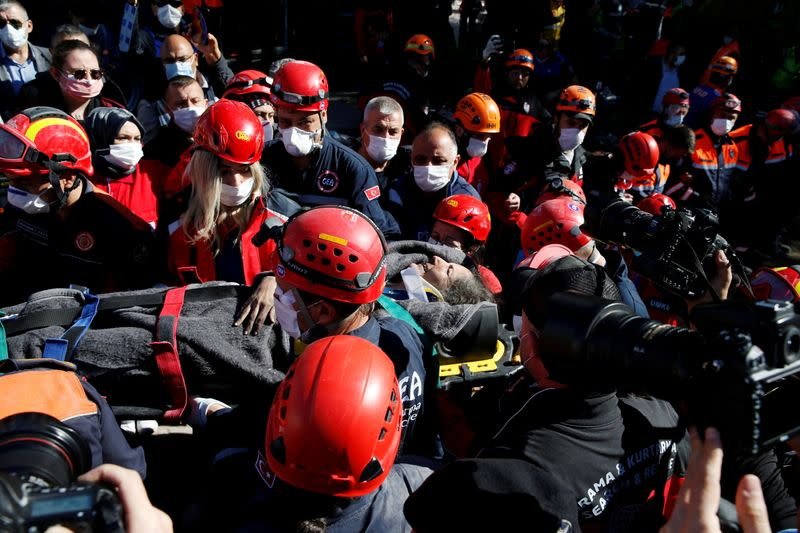 Rescue workers search for earthquake survivors in Izmir