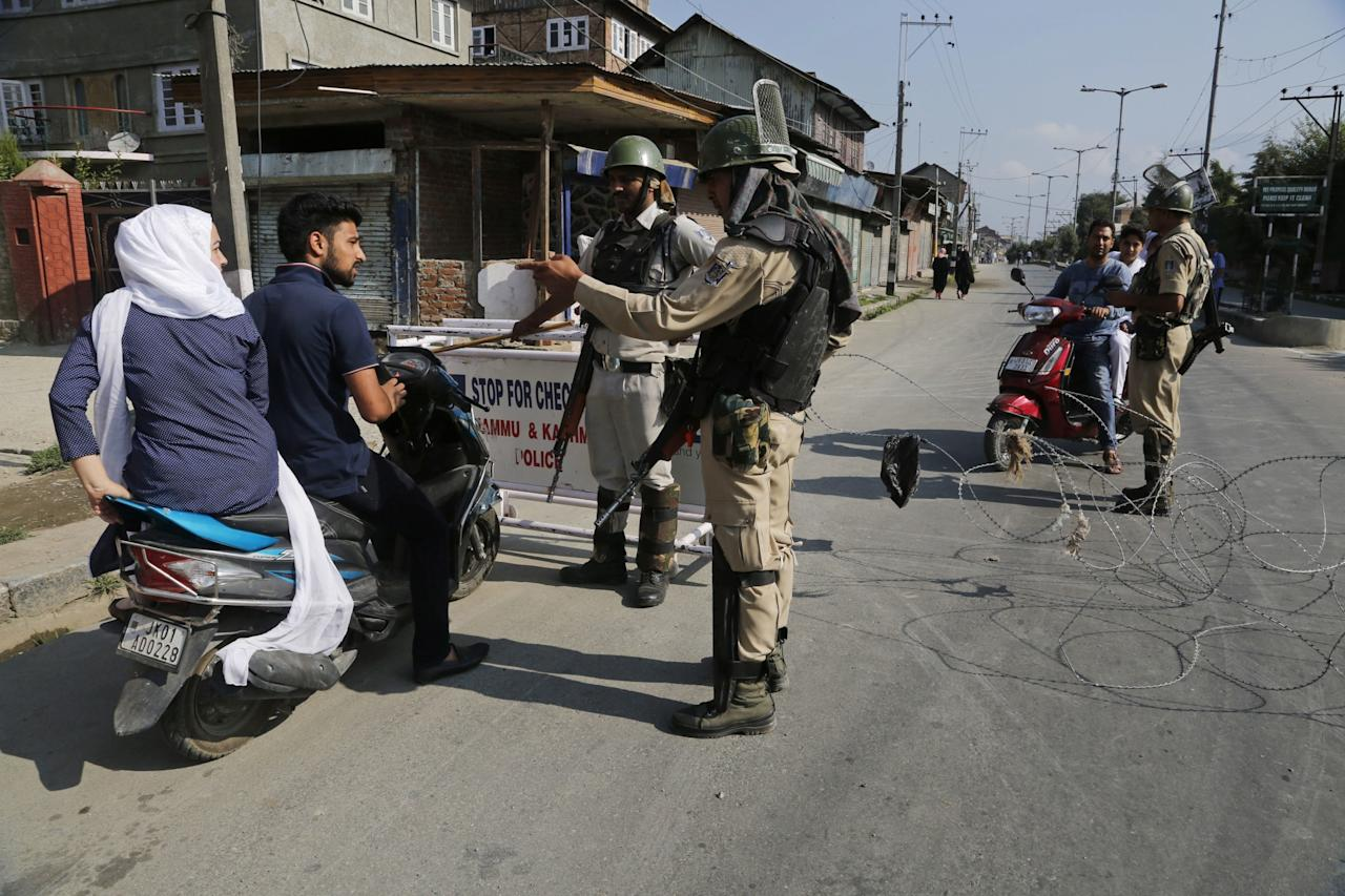 <p>Kashmiri's ask for permission to cross a temporary checkpoint during restrictions in Srinagar, Indian controlled Kashmir, Tuesday, July 25, 2017. Kashmiri separatists have called for a strike on Tuesday to protest against the arrest of seven separatist leaders by India's National Investigation Agency on charges of receiving funds from Pakistan-based militant groups. (AP Photo/Mukhtar Khan) </p>