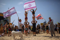 People protest against government's decision to close beaches during the three-week nationwide lockdown due to the coronavirus pandemic, in Tel Aviv, Israel, Saturday, Sept 19, 2020. Israel went back into a full lockdown on Friday to try to contain a coronavirus outbreak that has steadily worsened for months as its government has been plagued by indecision and infighting. (AP Photo/Oded Balilty)