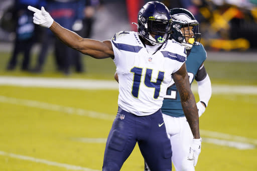 Seattle Seahawks' DK Metcalf reacts after a first down catch during the first half of an NFL football game against the Philadelphia Eagles, Monday, Nov. 30, 2020, in Philadelphia. (AP Photo/Chris Szagola)