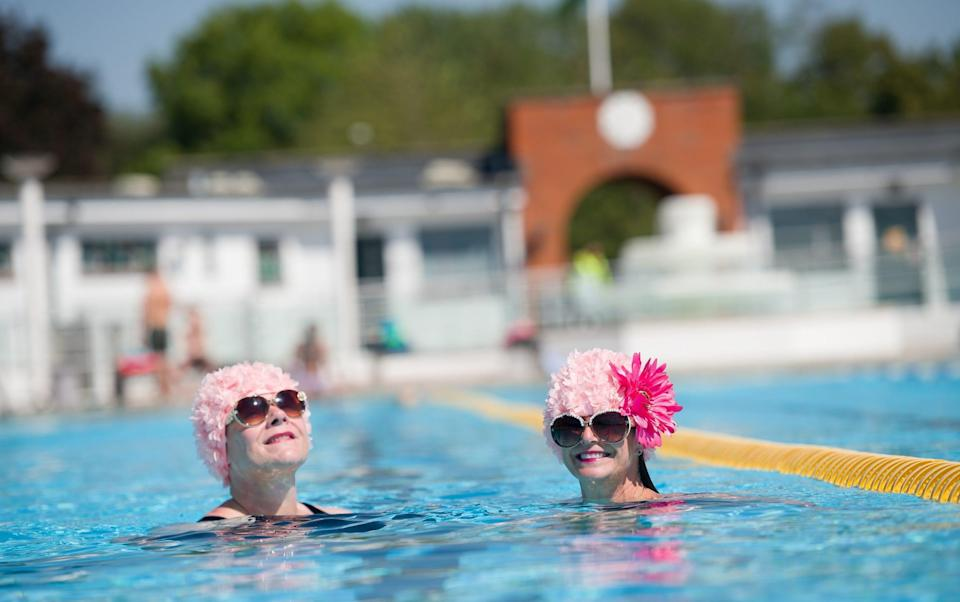 Swimmers in the London borough of Hillingdon on July 31 - Leon Neal/Getty Images