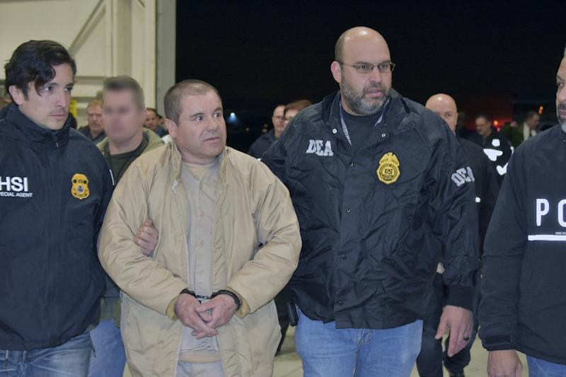 "Los Tucanes rose to fame -- or infamy, some would say -- with ""narcocorridos,"" songs that celebrate the exploits of Mexico's drug traffickers including Joaquin ""El Chapo"" Guzman, pictured during his 2017 extradition to the US (AFP Photo/HO)"