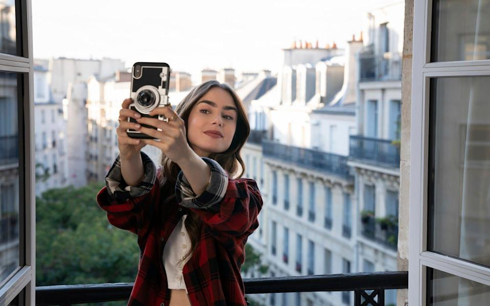 "Lily Collins in a scene from the series ""Emily in Paris""  - Stephanie Branchu /Television Stills"