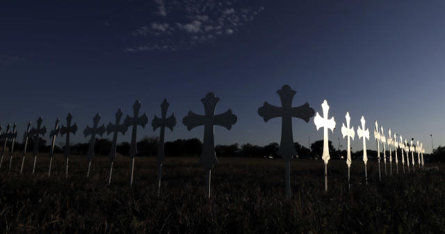 <p>The sun is reflected on some of the 26 crosses placed in a field before a vigil for the victims of the First Baptist Church shooting Monday, Nov. 6, 2017, in Sutherland Springs, Texas. (Photo: David J. Phillip/AP) </p>