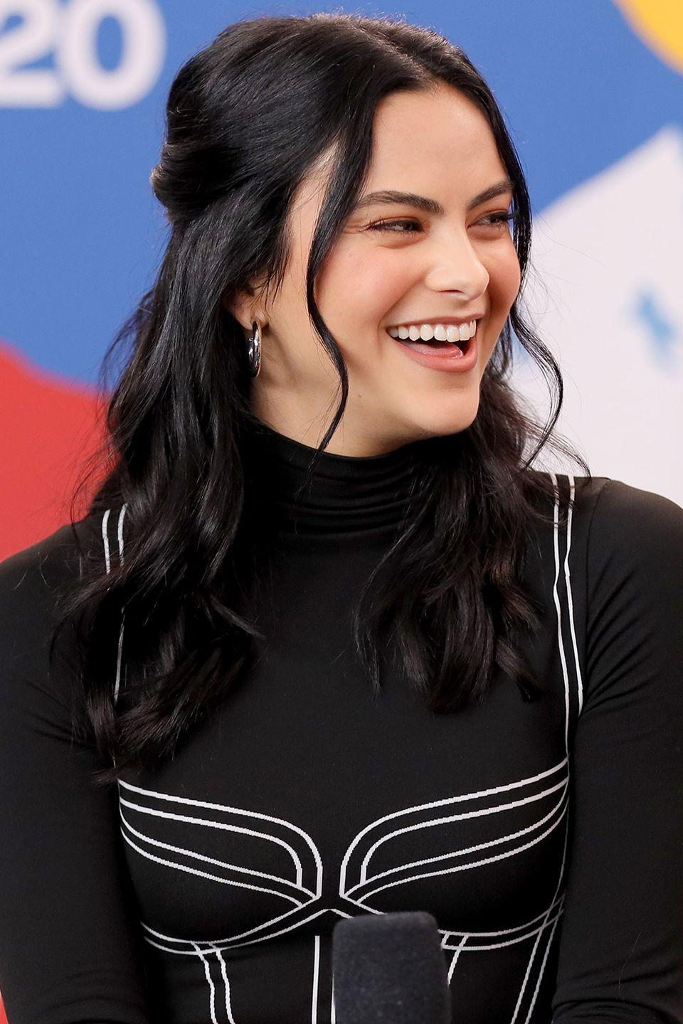 <p>Camila Mendes wears her hair in loose curls, with some gathered at the back and short layers out front to frame her face. </p>