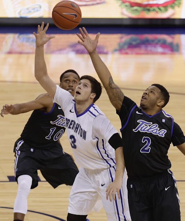Creighton forward Doug McDermott (3) and Tulsa guards Pat Swilling Jr. (2) and James Woodard (10) go for a rebound in the first half of an NCAA college basketball game in Omaha, Neb., Saturday, Nov. 23, 2013. (AP Photo/Nati Harnik)